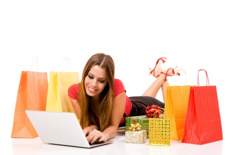 Beautiful young woman shopping over internet